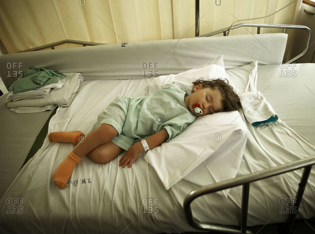 Sick girl sleeping in a hospital