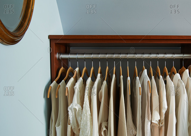 White blouses hanging on a rack