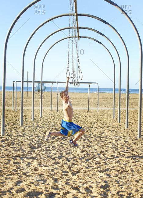 Man swinging on gymnastic rings