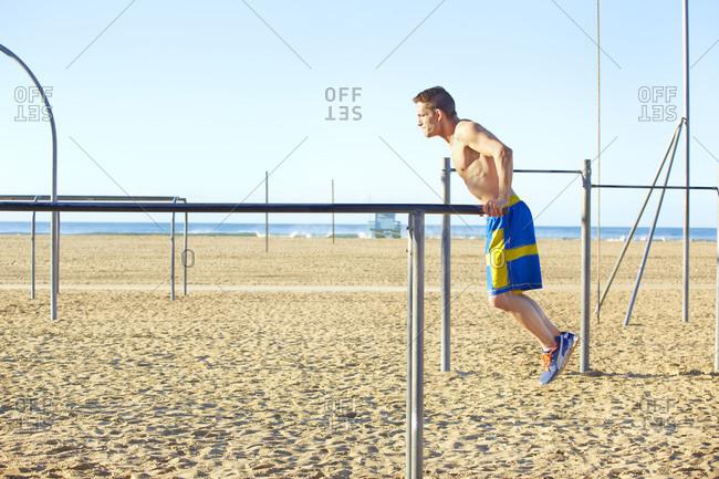 Man exercising on a chin-up bar
