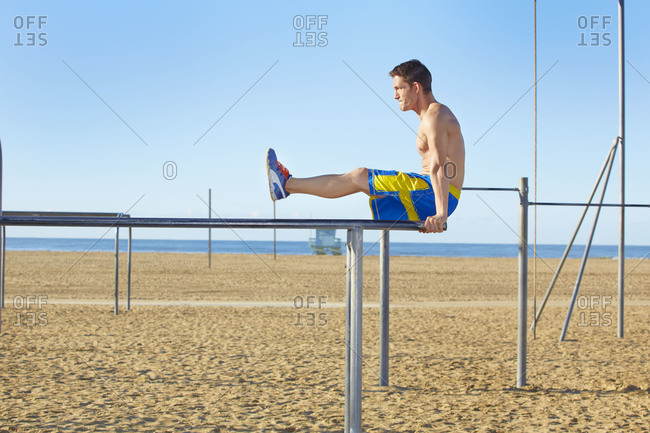 Man working out on a chin-up bar