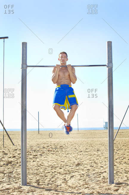 Man doing pull-ups on a chin-up bar