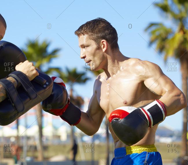 Man practicing at a Muay Thai training