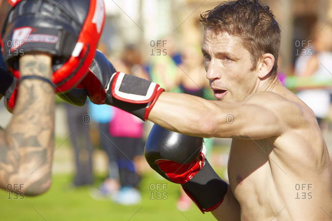 Man practicing punches at a training