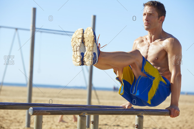 Man working out at an outdoor gym
