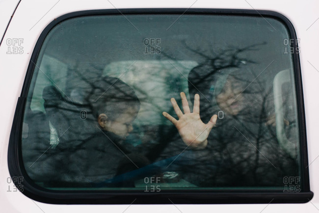 Child touching a car window