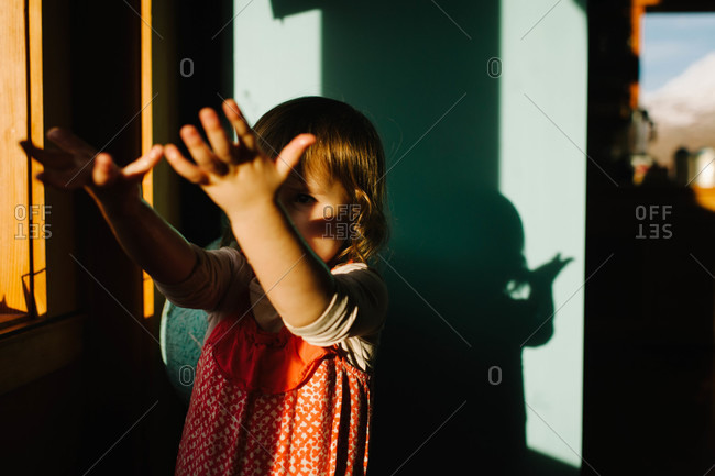 Young girl reaching out her arms