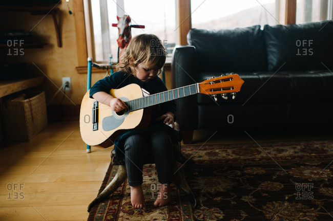 Young girl playing the guitar