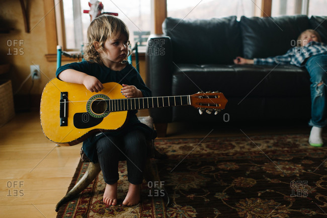 Young girl holding a guitar