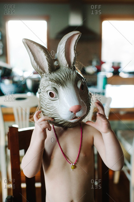 Portrait of child wearing a bunny mask