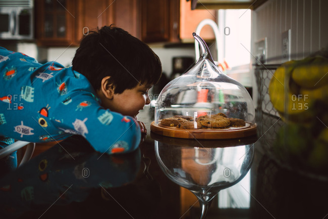 Child looking at cookies on kitchen counter