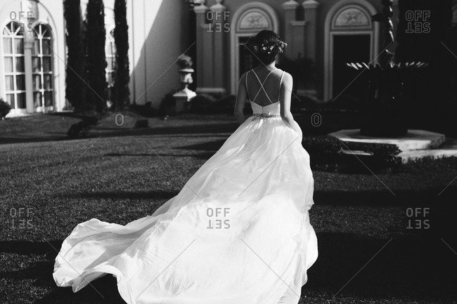 Bride in courtyard in flowing dress