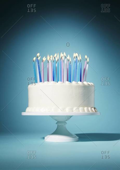 Still life of a birthday cake with candles