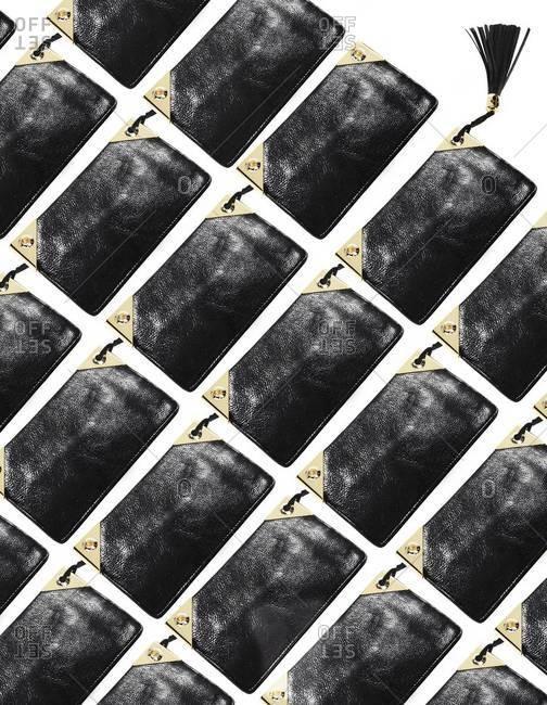 Studio shot of black handbags in a row
