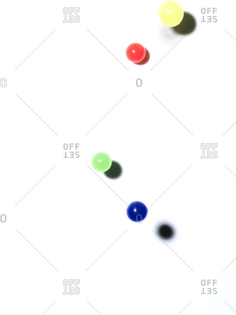 Colorful bouncy balls on white background