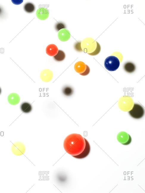Small bouncy balls against a white background