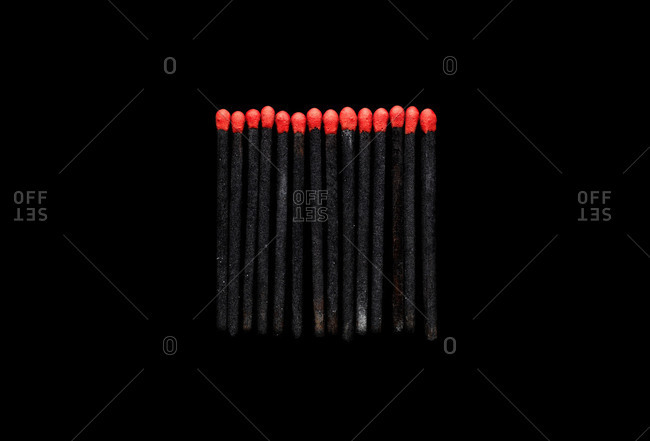 Burned matchsticks with the tips intact