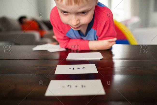 Young boy studying with math flash cards