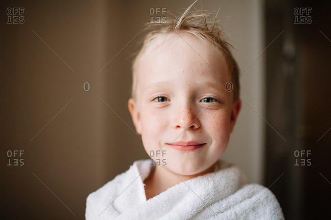 Young boy covered with a towel