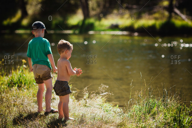 Young boys standing at the Firehole river in Wyoming, USA