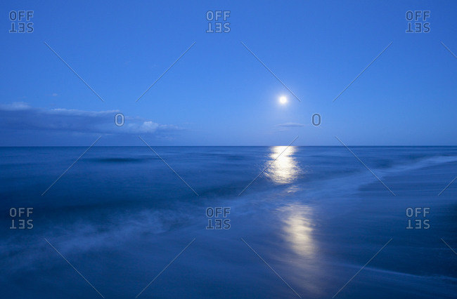 Full moon above the sea