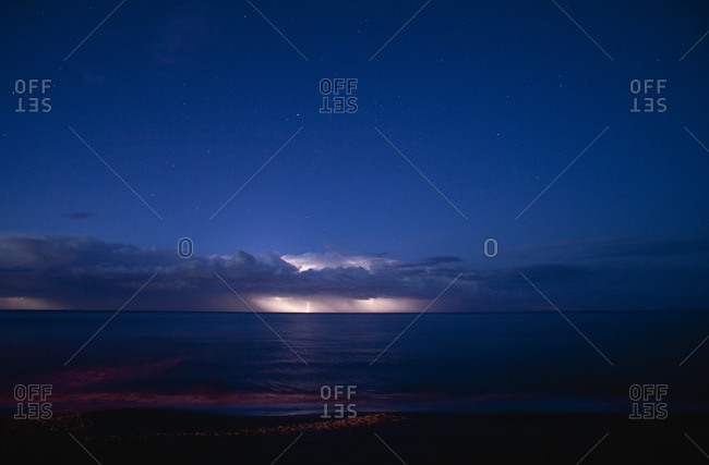 Thunderstorm above the sea at night