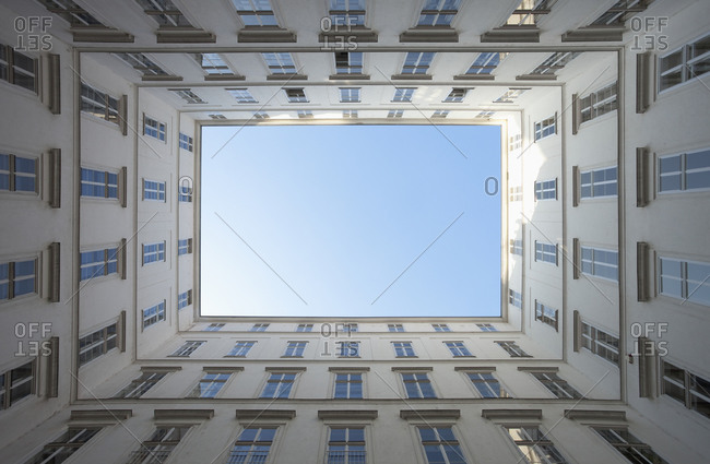 Looking up in a courtyard of an apartment building in Vienna