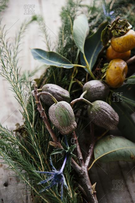 Wreath made of persimmon, eucalyptus pod and sea holly