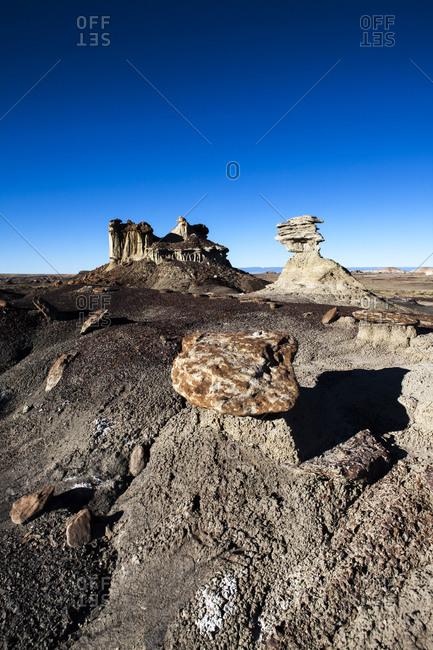 Unique rock formations in vast rugged desert terrain