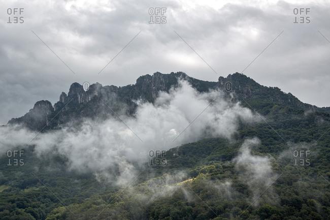 Cloudy view of Mountain Denti della Vecchia, Ticino, Switzerland