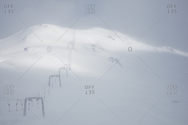 Ski lift in a blizzard, Oberalppass, Switzerland