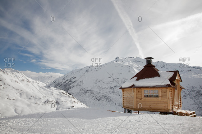 View of Swiss Asps with alpine chalet