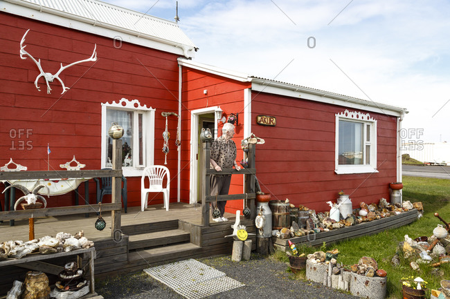 Grindavik, Iceland - June 11, 2014: An old woman at her house in a fishing town