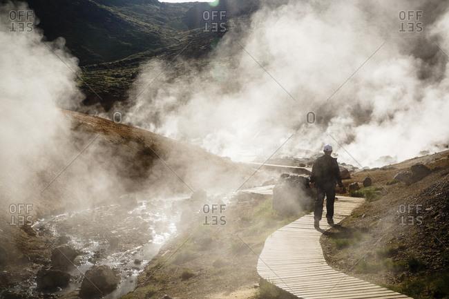 A man at a geothermal field in Krysuvik, Reykjanes Peninsula, Iceland