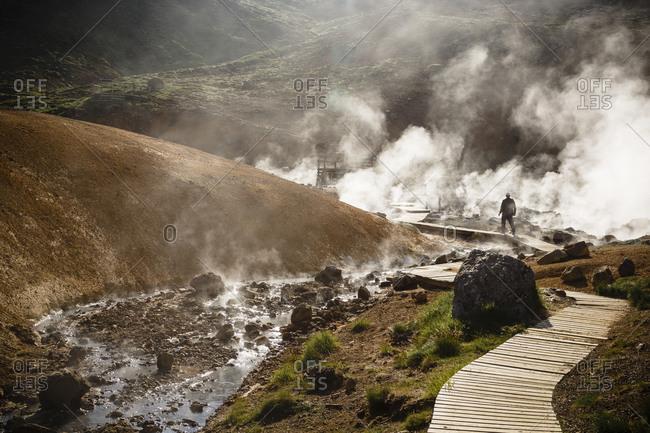 A man visiting a geothermal field in Krysuvik, Reykjanes Peninsula, Iceland