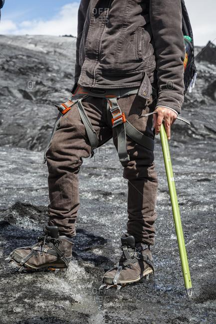 A man on Sólheimajökull  glacier, South Iceland