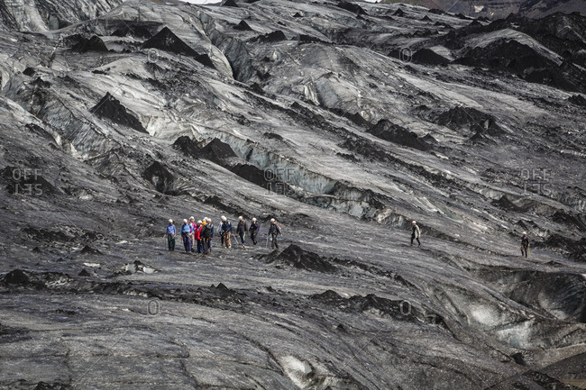 South Iceland - June 13, 2014: People walking on Sólheimajökull Glacier