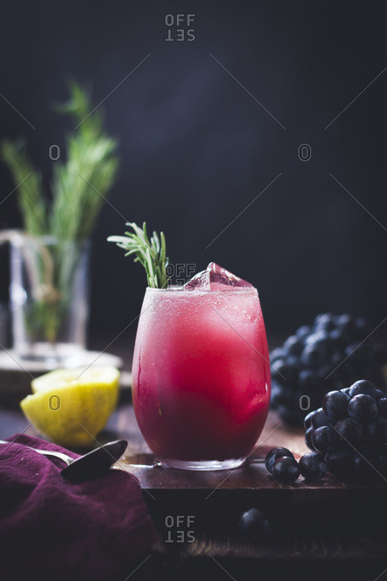 Rosemary grape cocktail on a table