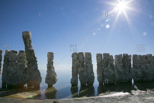 Salton Sea, California, USA - February 4, 2015: Salt and barnacle-crusted pillars rising out of the Salton Sea