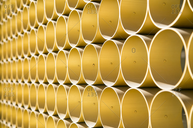 Modern wall made of yellow cylinders