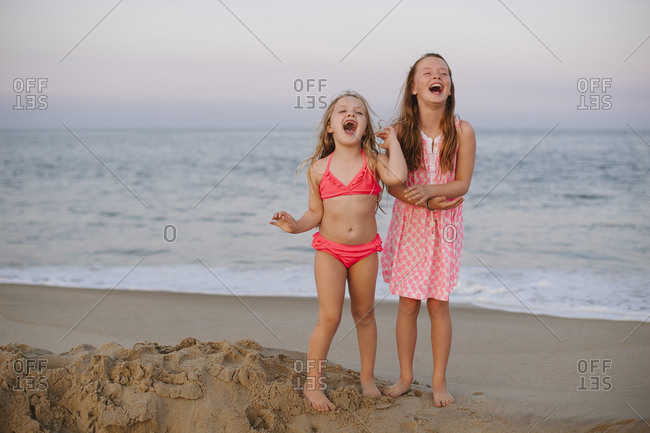 Two young girls on the beach yelling