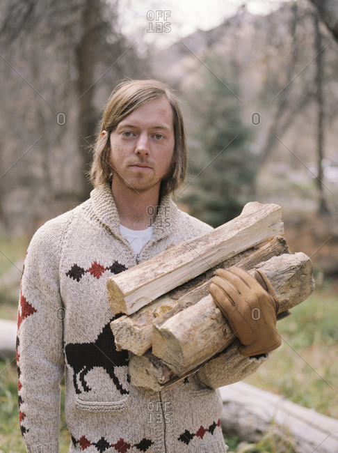 Portrait of a man with firewood