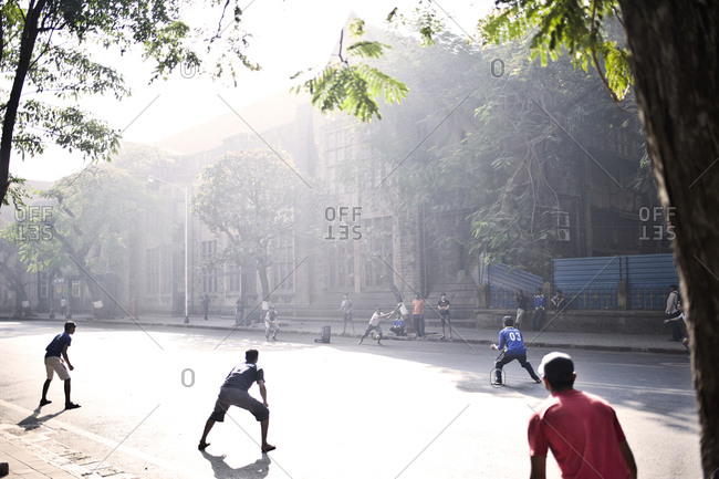 Mumbai, India - February 8, 2015: Boys playing cricket on a street