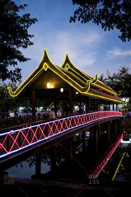 Siem Reap, Cambodia - December 19, 2014: Illuminated Asian bridge at dusk
