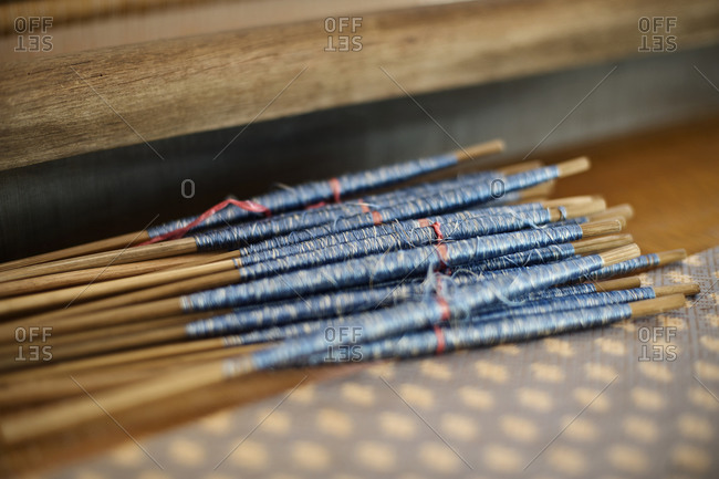 Close up of silk on weaving loom