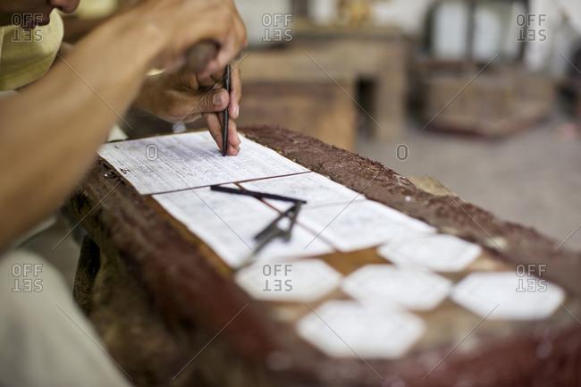 Man engraving in a workshop