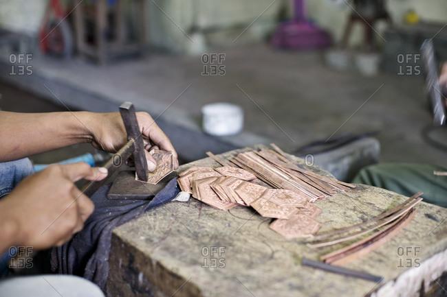 Man hammering in a workshop