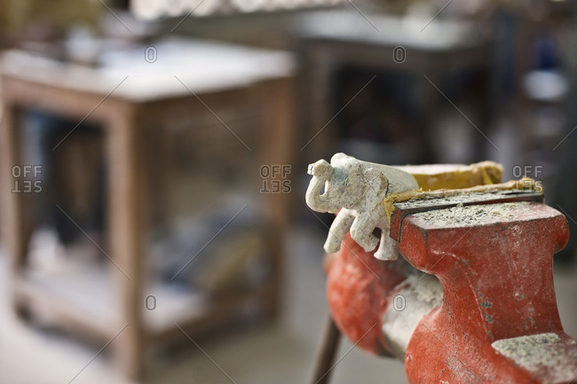 Elephant figurine in a vise