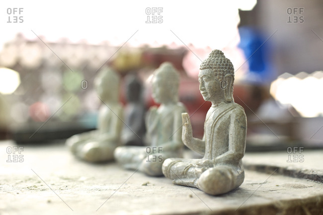 Carved Buddha statuettes in a workshop