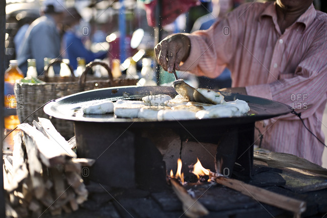 Man preparing fish at a street market